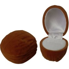 This walnut ring box is perfect for presenting a ring to someone who loves walnuts.<br>Ring box Height 40mm x Width 40mm x Depth 50mm.<br>The ring box is made from luxurious velvet and inside is a precut slot in white flocked foam to keep your ring n